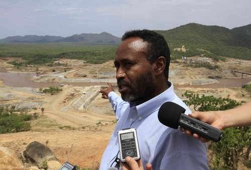 Bekele, project manager of Ethiopia's Great Renaissance Dam, addresses journalists during a media tour in Guba Woreda