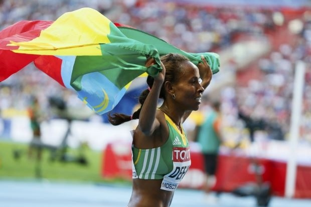 Meseret Defar of Ethiopia celebrates her victory in the women's 5000 metres final of the IAAF World Athletics Championships at the Luzhniki stadium in Moscow August 17, 2013. REUTERS/Lucy Nicholson