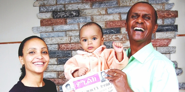 Serkalem Fasil, baby son Nafkot and husband Eskinder Nega, who was imprisoned in 2012