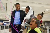This Ethiopian runner was an Olympic hopeful — before he was tortured and fled. Today, he reunited with his family in the U.S